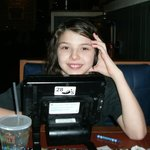 My daughter in chilis playing on their table video games