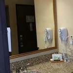 Granite counter top , hair dryer, and little shampoo, lotion, etc....very clean. Smell great.