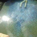 Dirty pool water flowing