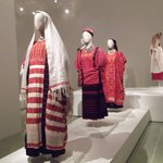Colorful woven fabrics in women's traditional styles