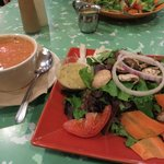 cup of soup (tomato bisque) with lite greens