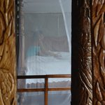 four poster bed reflected in a mirror.