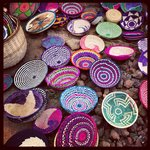 Women weave baskets on site at Red Rocks. They are happy let you give it try.