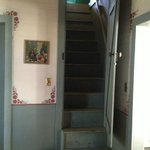 Stairway to the bedroom lofts, off of the kitchen.