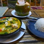 Yellow curry with fish and an ice cold coconut
