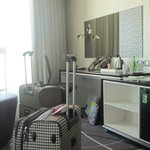 Desk with shelves and a mini-fridge.