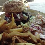 Bison premium burger with mushrooms, onions and tomatoes.