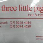 Signage of Three Little Pigs contact