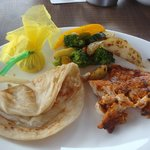 grilled fish and vegetables with parotta