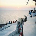 Sunset at Mylos Cafe Bar Restaurant  Firostefani, Santorini