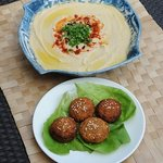 Plate of our delicious falafels and another of our creamy hummus. All our food is prepared same