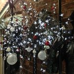 contemporary christmas tree lit up with baubles and lights!