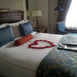 Anniversary bedroom decorations by hotel staff