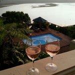 Enjoying a glass of wine on the balcony