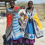 Masai women pose for photographs