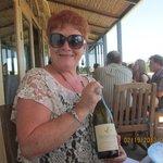 enjoying a bottle of De Grendal wine
