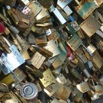 buy a lock, attach it to the bridge, then throw the key in the Seine