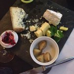Cheese - A platter of cheeses from around the world, crackers, chutney, pickled onions and celer