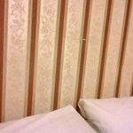 no headboard, just some of the damaged wallpaper