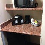 Mini fridge and tiny microwave.