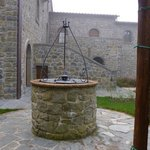 The well in front of the spa suites at La Corte dei Papi