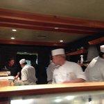 Directly at the sushi bar