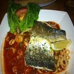 Baked Sea Bass fillets with spicy tomato seafood linguine