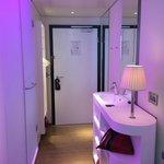 bathroom area - toilet & shower on left, sink & vanity on right