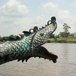 Bronze dragon on river promenade