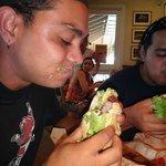 braddah blake pounding his burger