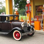 Bring your antique car and take its picture at the gas station.
