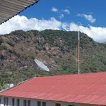view from 3rd floor area, local rooftops and mountains
