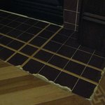 Tiles at base of fireplace
