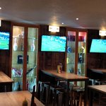Pict of multi tv screens showing sports and live football