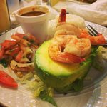 Stuffed avocado with shrimp with beans and rice and Chilean salad as sides