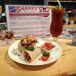 Sharky's Breakfast Burrito served with pico de gallo and sour cream