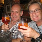 Our husbands enjoying Aperol Spritz in Osteria Baralla Lucca