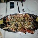 Grilled sea food, shells, shrimps, lobster, fish...