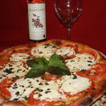 Margarita Pizza made with our from scratch mozzarella and roma tomato...in our Wood Fired oven