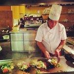Cook preparing fresh ingridients
