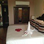 Bed over to wooden bathroom window doors