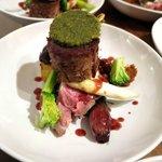 Duo of Lamb. Confit lamb steak, slow roasted lamb rack, potato fondant, sweet garlic puree...