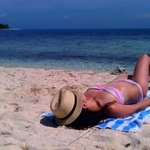 Tanning on Silk Caye Island during Snorkeling