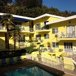 Inner hotel area. You go up yellow steps from street to enter reception introducing pool & rooms