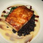 Signature Salmon over black sticky rice