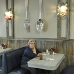 Giant fork and spoon decorations inside the dining area.
