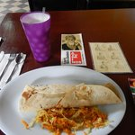 Lunch of pineapple water and a beef burrito, notice sign card to help with communication