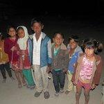 Children from village welcome when we return.