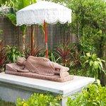 A reclining Buddha statue just beside the restaurant