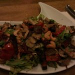 Salad with mushrooms, cashew nuts, sundried tomato